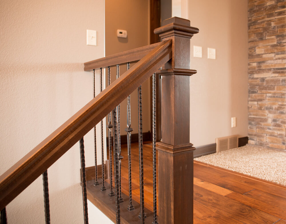 <a href='/interior-products/stair-systems/post-to-post/4091'>4091</a> Box Newel  |  <a href='/interior-products/stair-systems/post-to-post/5540'> 5540</a>, <a href='/interior-products/stair-systems/post-to-post/5541'> 5541</a> & <a href='/interior-products/stair-systems/post-to-post/5542'> 5542</a> Forged Iron Balusters  |  S.O. Rail  |  <a href='/interior-products/moulding/casing/176a'> 176</a> Knotty Alder Casing